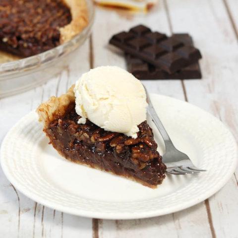 chocolate bourbon pecan pie with vanilla ice cream