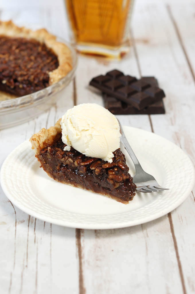 chocolate bourbon pecan pie with vanilla ice cream