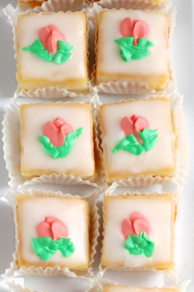 a tray of classic almond petit fours with fondant icing