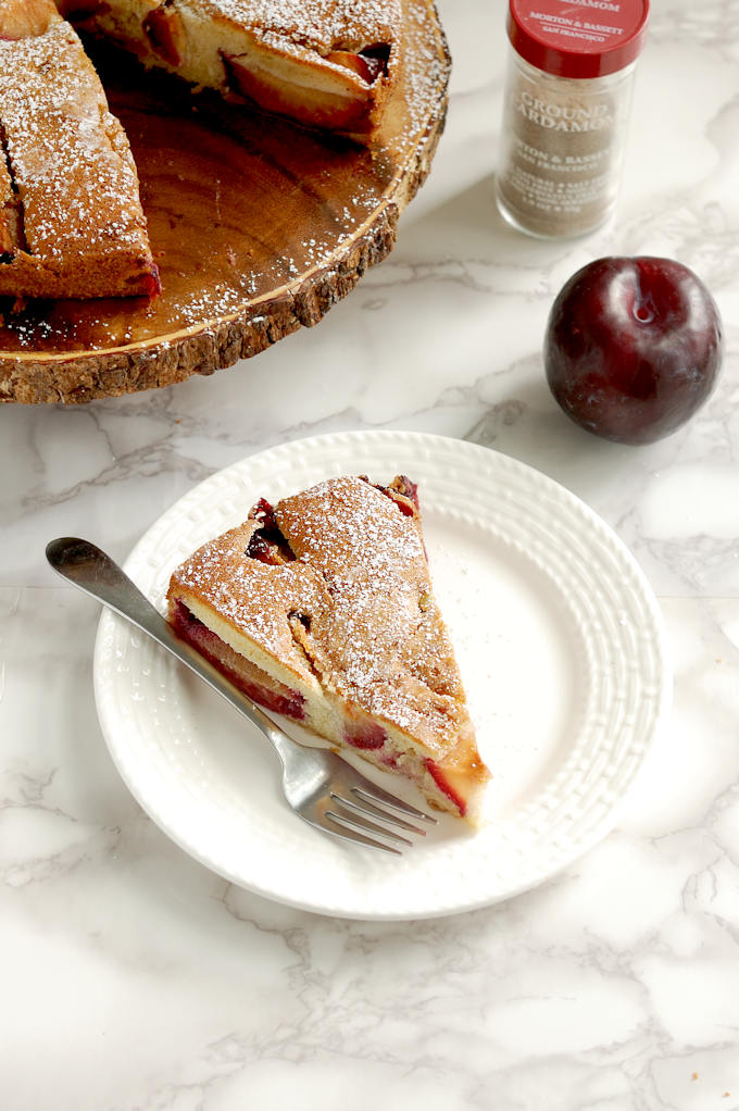 rustic plum cake with cardamom plated