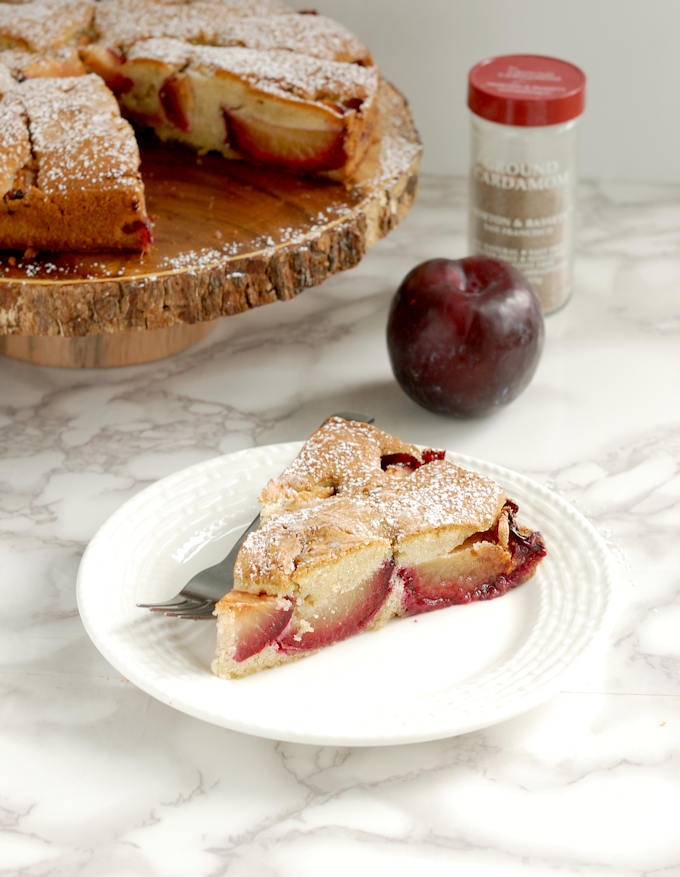 a slice of rustic plum cake with cardamom
