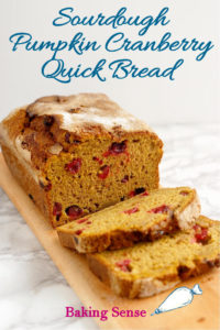 """Sourdough Pumpkin Cranberry Quick Bread is a super moist, easy to make bread has a wonderful flavor & texture thanks to """"discard"""" sourdough starter. Fresh cranberries add another tangy pop to the flavor of the bread."""