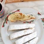 sliced almond stollen on a christmas plate