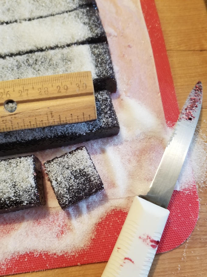 cutting blackberry pate de fruit