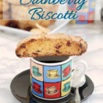 a pinterest image for ginger cranberry biscotti with text overlay