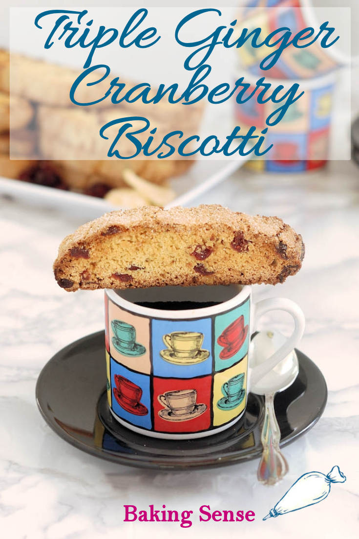Triple Ginger & Cranberry Biscotti are flavored with ginger 3-ways and studded with sweet/tart craisins. Perfect for dunking into coffee, espresso or dessert wine. #easy #candied #fresh #dry #craisins #cranberry #best #oliveoil #scratch #recipe