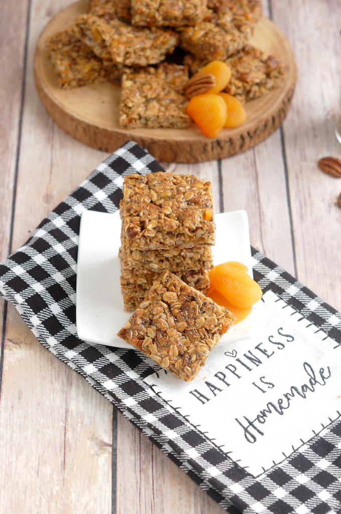 sunflower, pecan and apricot granola bars on a plate