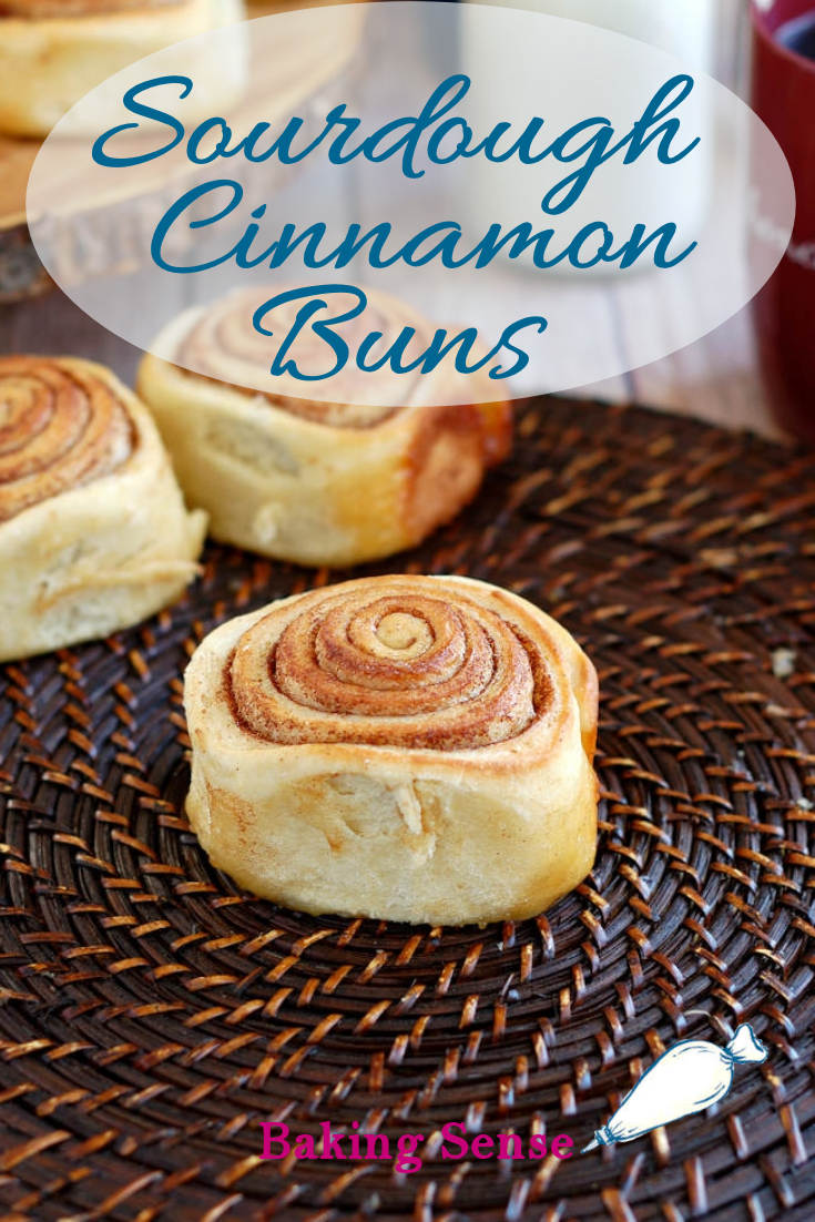 """Does anything in the world smell as good as freshly baked Cinnamon Buns? A long slow rise gives these Sourdough Cinnamon Buns an extra special flavor & texture.  The warm buns are topped with cream cheese frosting for an indulgent breakfast or brunch treat, and there's a bonus """"sticky bun"""" layer at the bottom. #sourdough #cinnamon buns #recipe #overnight #homemade #scratch #cream cheese frosting"""