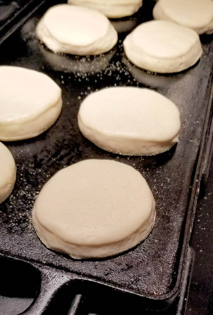sourdough english muffins on a griddle