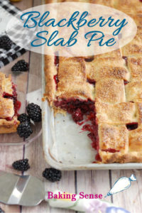 A pinterest image showing a blackberry slab pie with a piece cut out