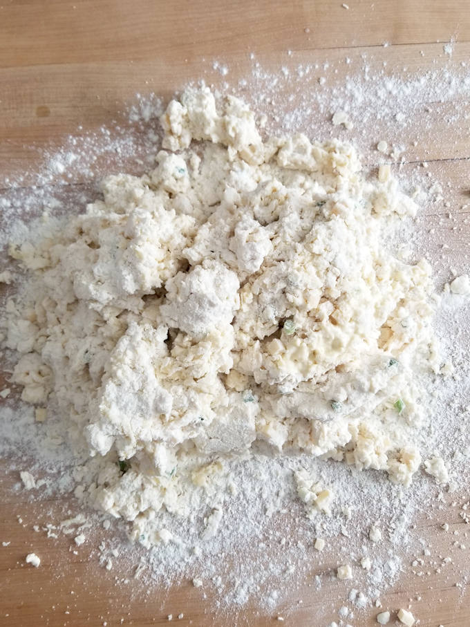 unkneaded scone dough on a floured surface