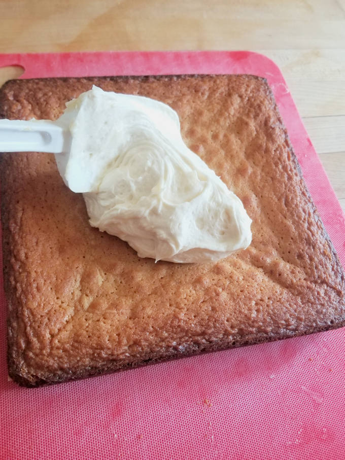 A blob of frosting on a malted milk blondies.