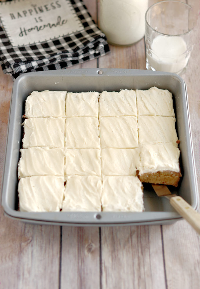 a tray of malted milk blondies with malted milk frosting.