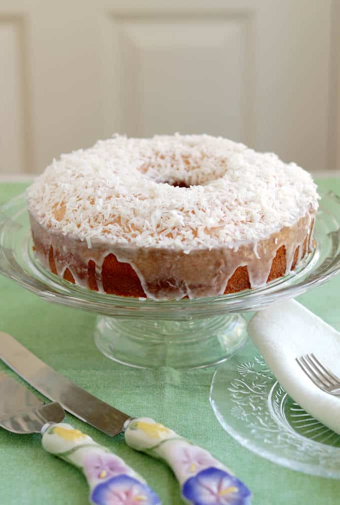 a coconut pound cake on a cake stand