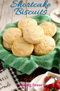 a basket of shortcake biscuits with text overlay for pinterest