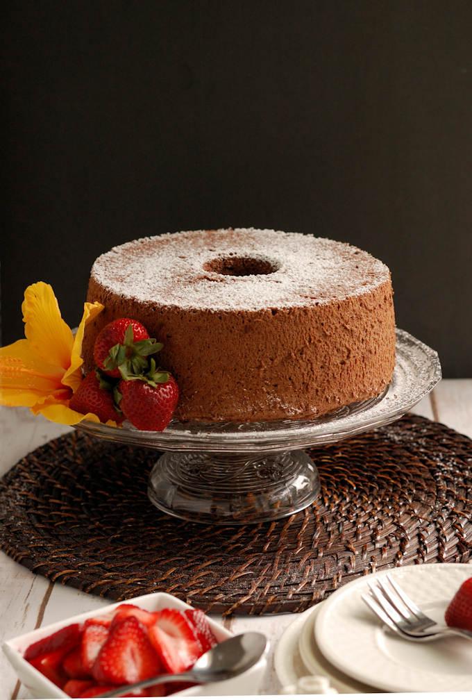 a chocolate angel food cake on a cake stand