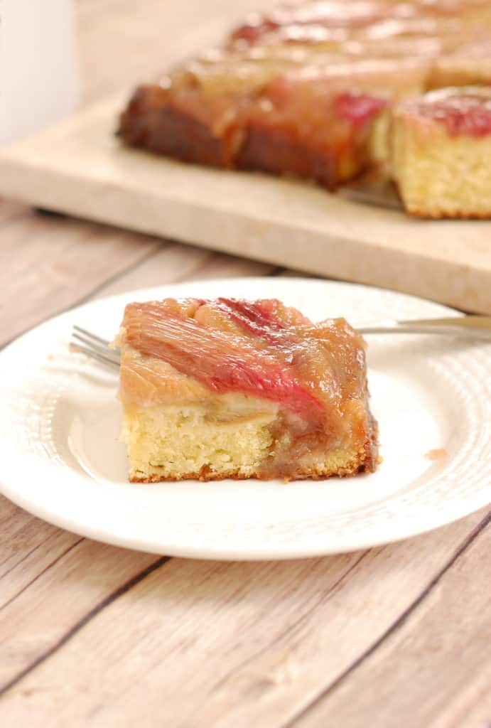 a slice of rhubarb upside down cake on a plate