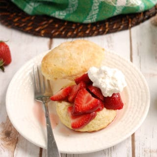 a strawberry shortcake on white plate