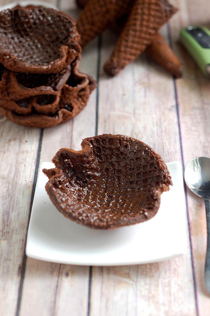 a chocolate coated waffle bowl on a plate
