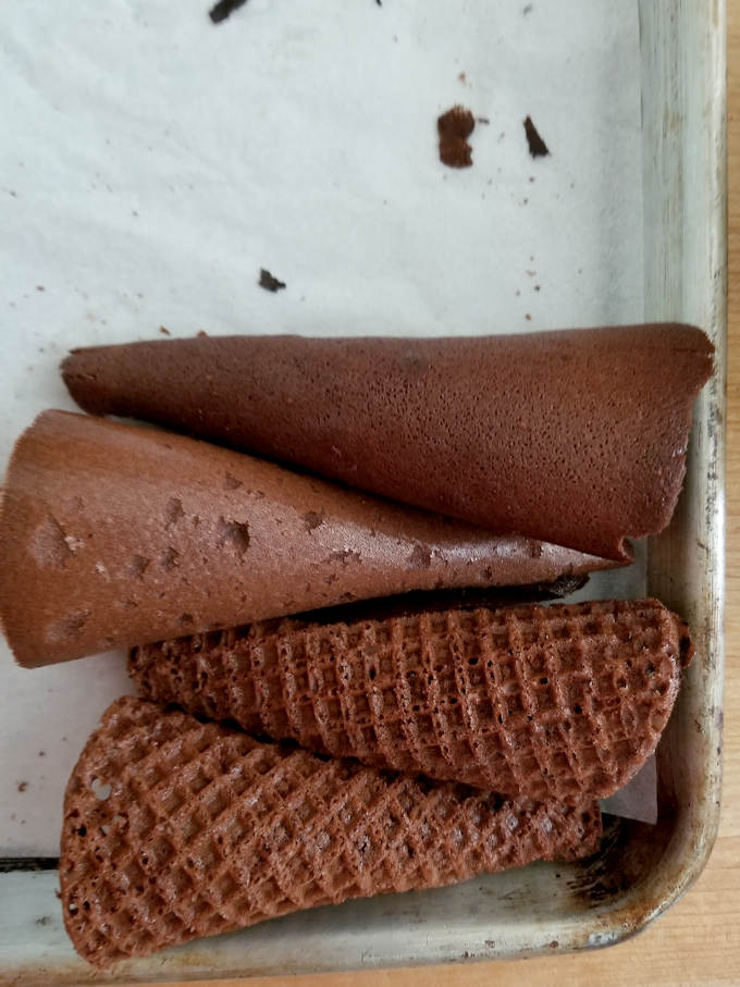chocolate waffle cones cooling on a tray