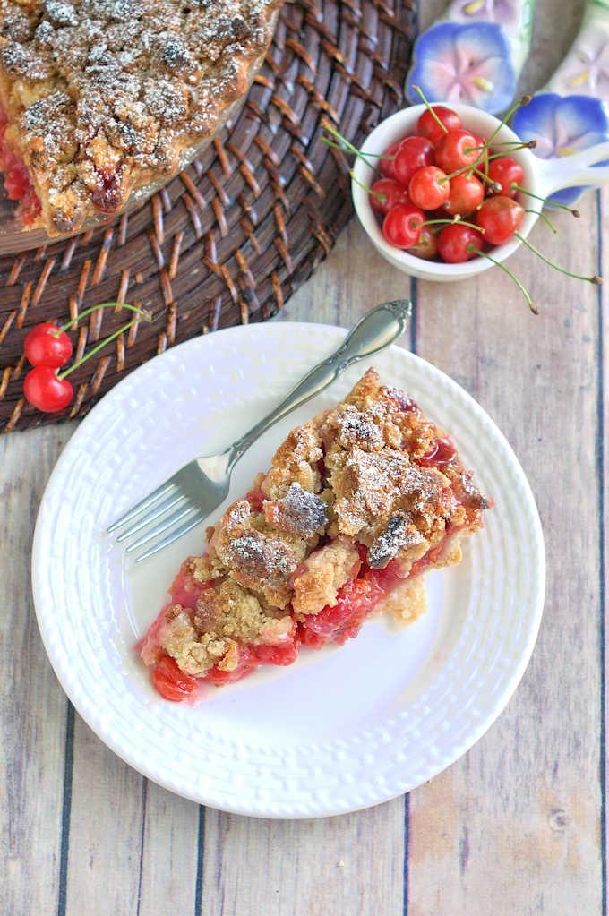 a slice of cherry crumb pie
