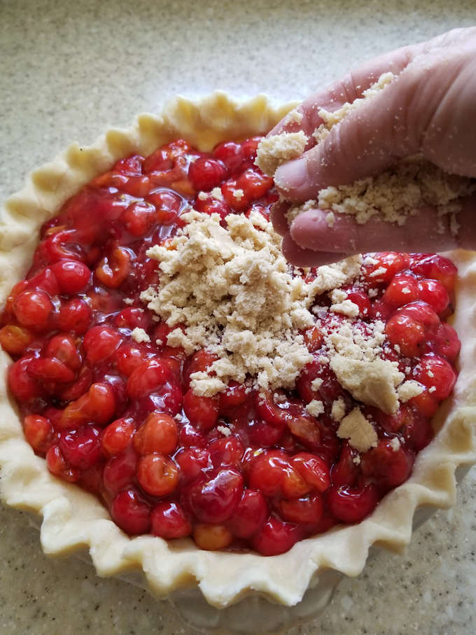 Adding crumb topping to a cherry pie