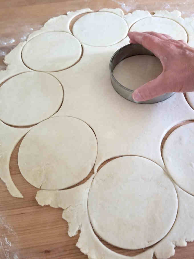 cutting rounds from cream cheese dough