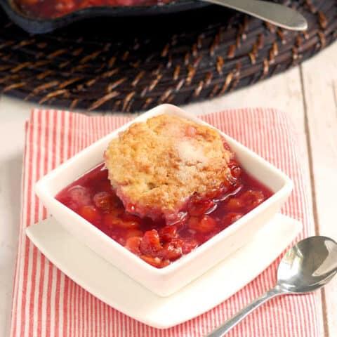 a bowl of sour cherry cobbler