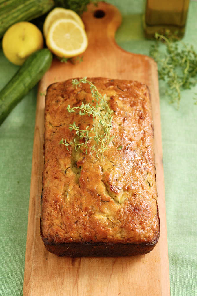 a loaf of lemon zucchini bread with olive oil and thyme