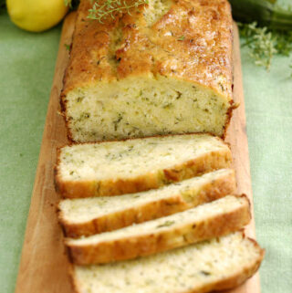 a sliced loaf of lemon zucchini bread