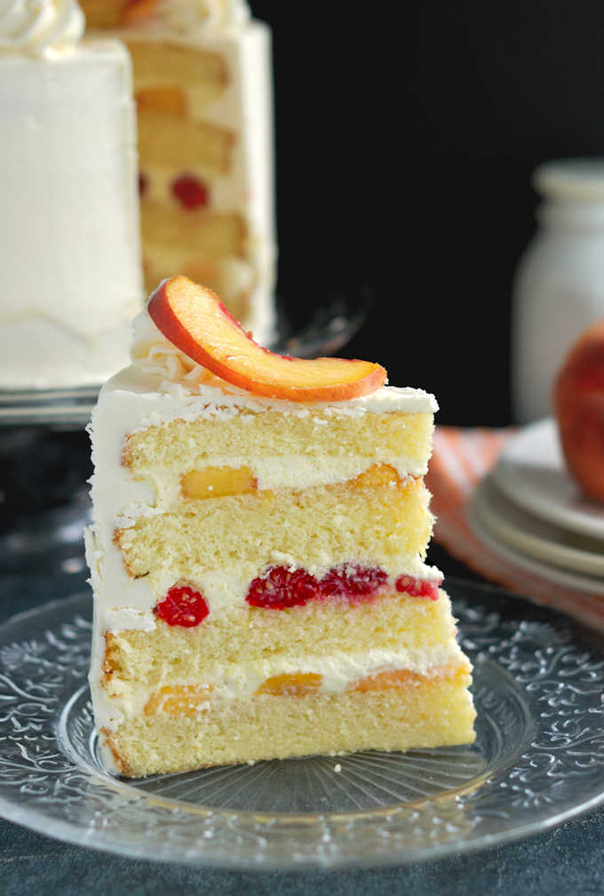 a slice of peach melba cake on a plate