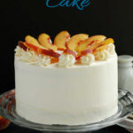 a pinterest image for peach melba cake recipe