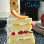 a pinterest image for peach melba cake