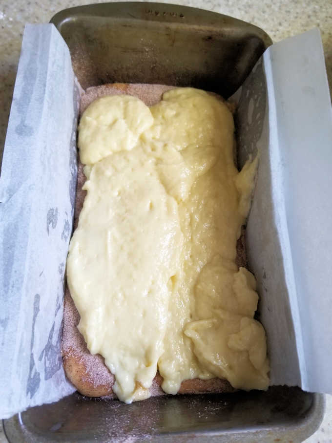 a loaf pan half full with batter