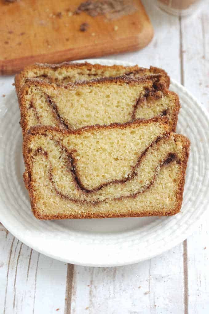 three slices of snickerdoodle bread on a white plate