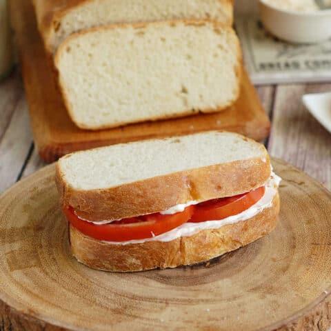 a tomato sandwich on sourdough sandwich bread
