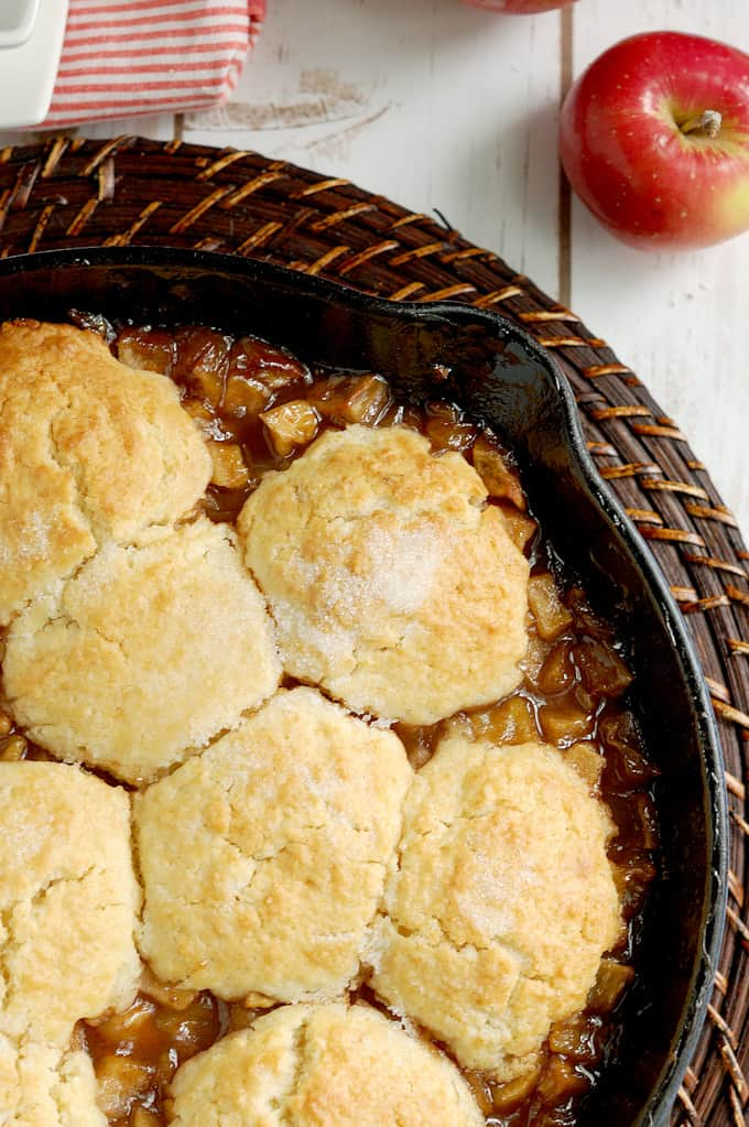 a closeup shot of a skillet filled with apple cobbler