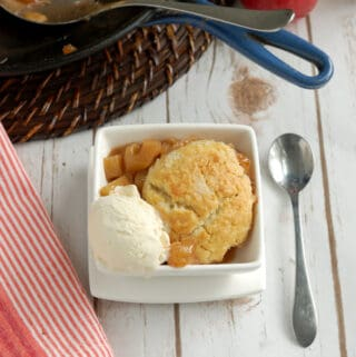 a bowl of apple cobbler with a scoop of ice cream