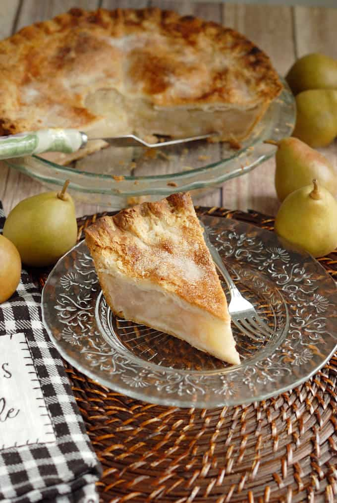 a slice of pear pie with sourdough crust on a plate