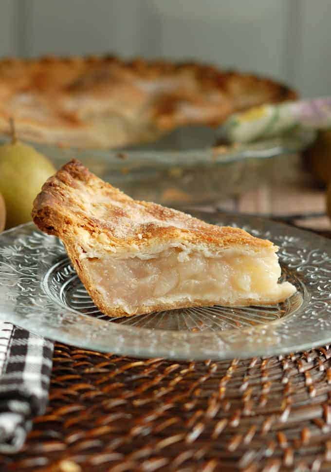 a slice of vanilla pear pie on a plate