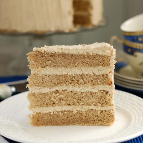 a slice of spice cake on a white plate