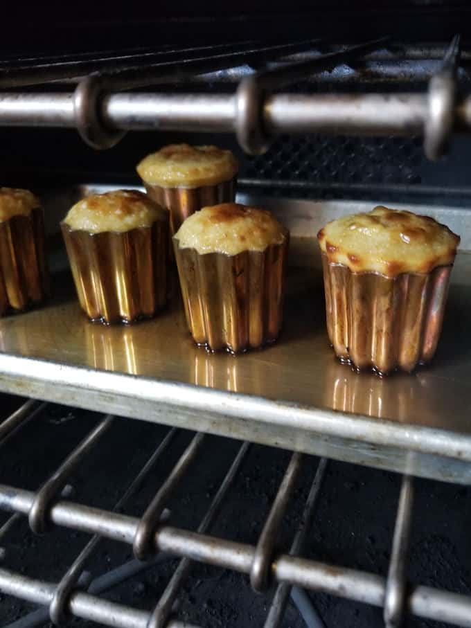 caneles baking in a hot oven