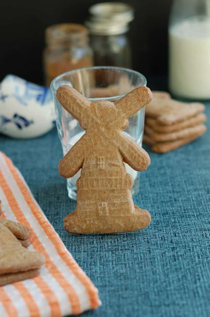 a speculaas cookie with a glass of milk