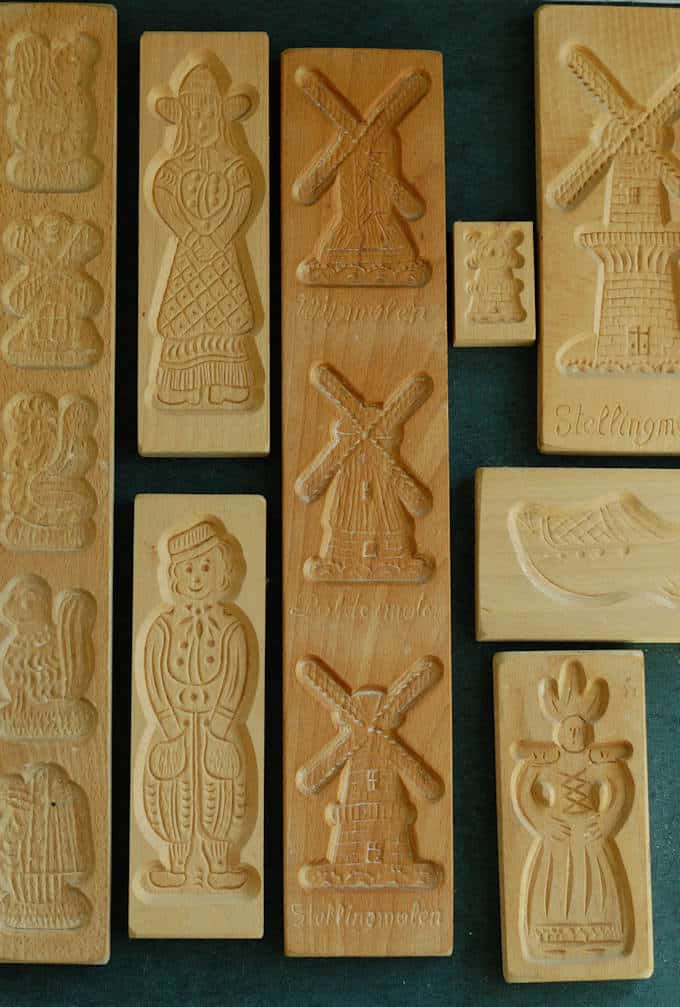 a collection of wooden speculaas cookie molds on a black background