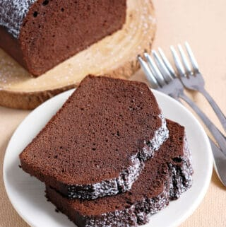 two slices of chocolate pound cake on a plate