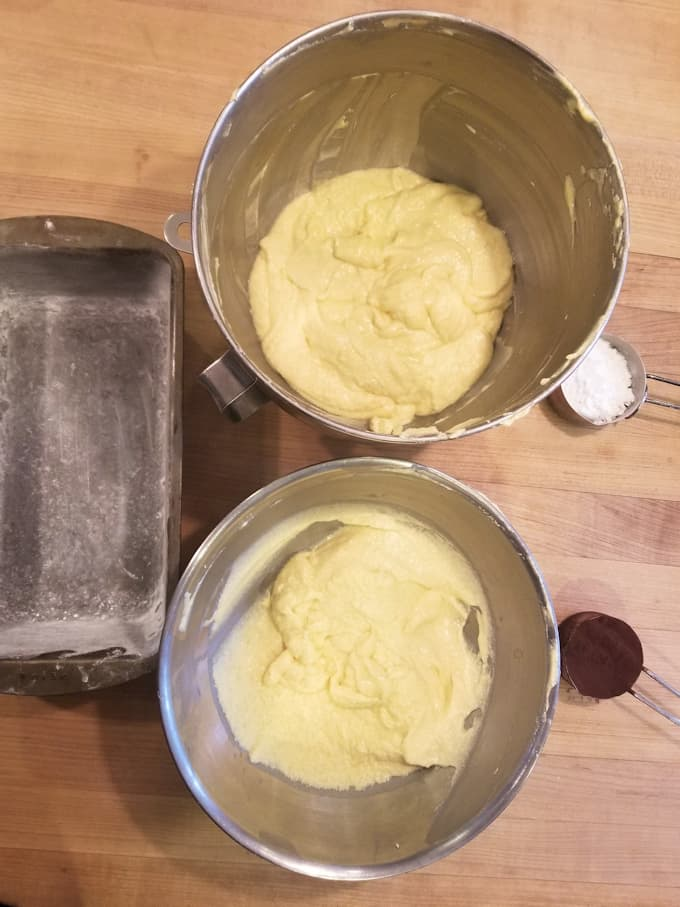 set up of batter, pan and cocoa for making marble pound cake