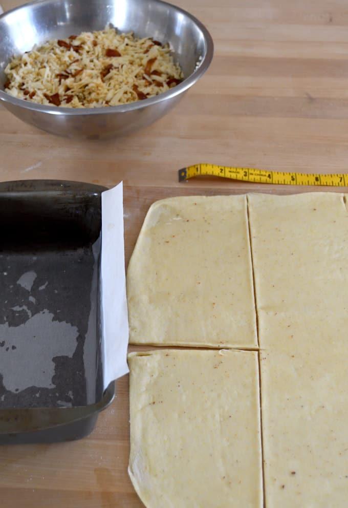 "Bread dough marked and cut into 4"" segments."