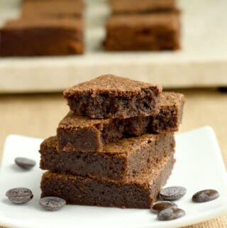 a stack of malted milk brownies on a plate