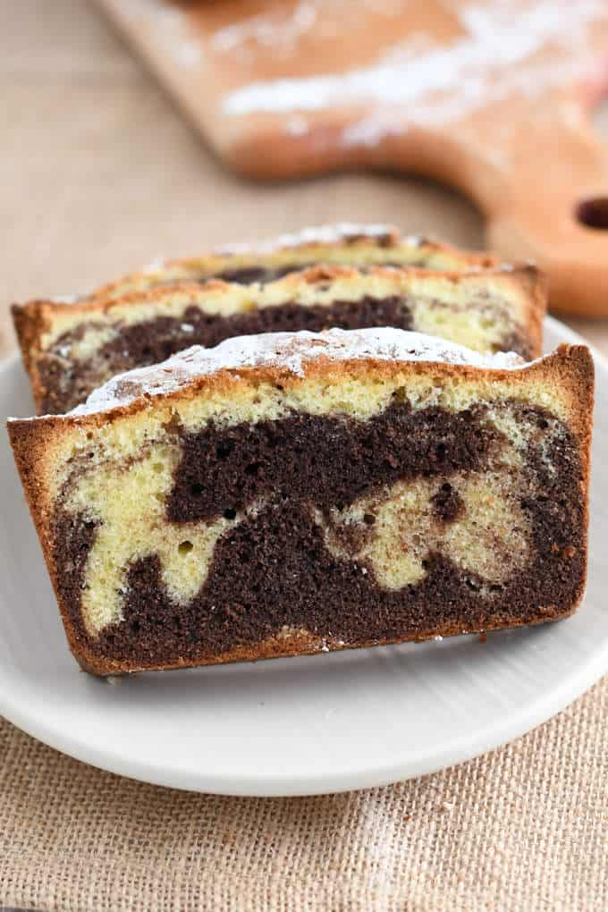 a slice of marble pounds cake on a plate