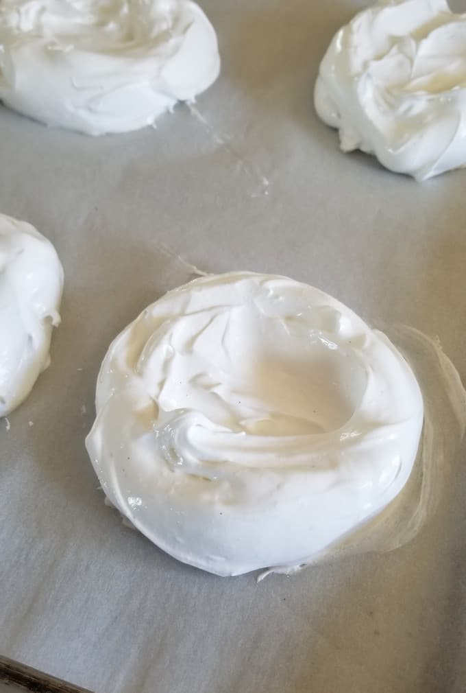 individual pavlovas on a tray ready to bake